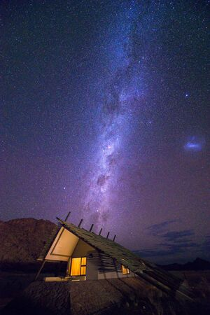 Milky way over a small chalet of a desert lodge near Sossusvlei in Namibia