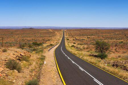 Empty road between Luderitz and Keetmanshoop near Garub in Namibia, Africa 写真素材