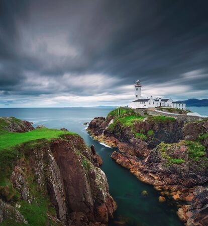 Dark clouds move over the Fanad Head Lighthouse in Ireland