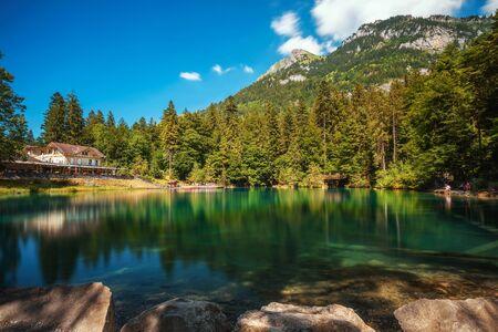 Mountain lake Blausee in the Jungfrau region of Switzerland 스톡 콘텐츠