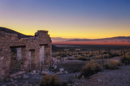 Sunrise above abandoned building in Rhyolite, Nevada