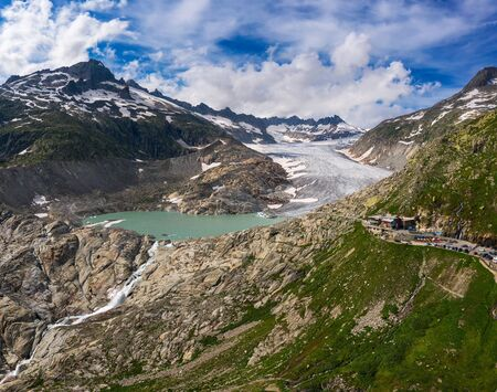 Aerial view of the melting Rhone glacier and the glacial lake in the Swiss Alps
