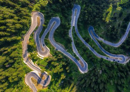 Aerial view of Maloja Pass road in Switzerland. This Swiss Alps mountain road is located in dense forests of the canton Graubunden.