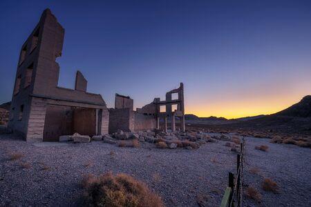 Sunrise above ruined building in Rhyolite, Nevada