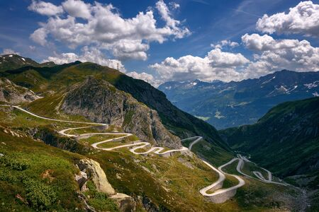 Aerial view of the old road with many serpentines going through the St. Gotthard pass in the Swiss Alps photographed from the Tremola Viewpoint.