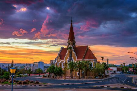 Dramatic sunset above Christchurch, Windhoek, Namibia Imagens