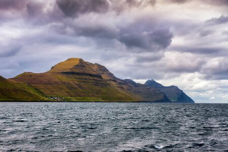 Village of Sydradalur and the island of Kalsoy in Faroe Islands, Denmark