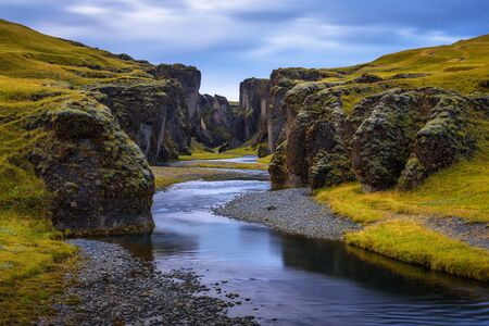Fjadrargljufur canyon and Fjadra river flowing at the bottom of the canyon in south east Iceland. Long exposure. 스톡 콘텐츠