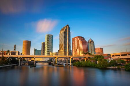 Tampa skyline at sunset with Hillsborough river in the foreground