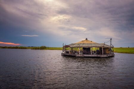 Empty floating bar and cafe on Chobe river in Botswana, south Africa 스톡 콘텐츠