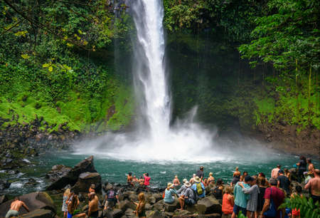 Tourists and locals visiting the La Fortuna waterfall in Costa Rica