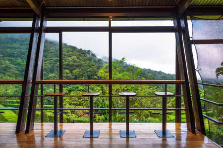 Interior of Celeste Mountain Lodge with views over rainforest in Costa Rica 에디토리얼