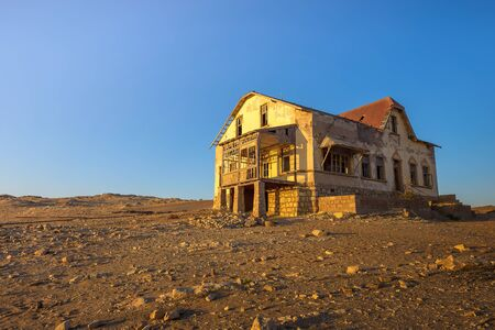 Sunrise above an abandoned house in Kolmanskop ghost town, Namibia
