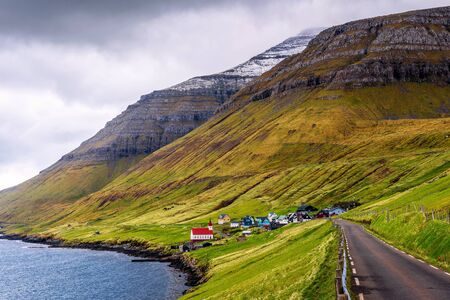 Village of Husar located on the island of Kalsoy in Faroe Islands 스톡 콘텐츠