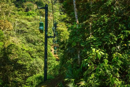 Cable car cabins riding through the tropical rainforest near Jaco in Costa Rica 스톡 콘텐츠