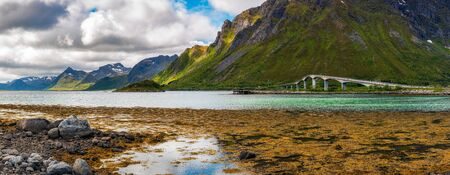 Bridge connecting Lofoten Islands in Norway with surrounding mountains 스톡 콘텐츠