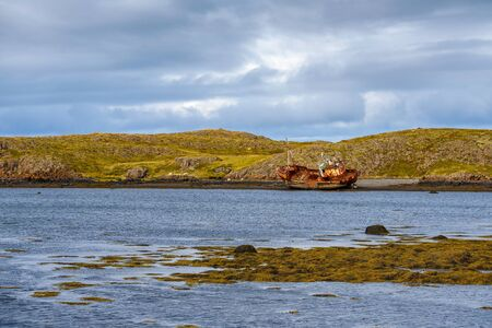 Fishing ship wreck laying on the Snaefellsnes peninsula in Iceland