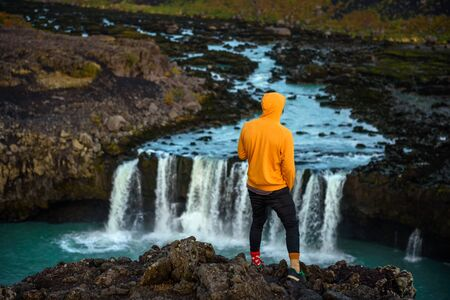 Hiker standing at the edge of the Thjofafoss waterfall in Iceland 스톡 콘텐츠