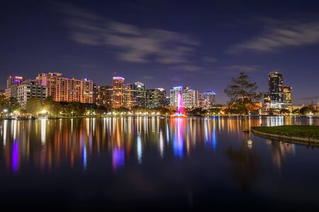 Night skyline of Orlando, Florida, with Lake Eola in the foreground