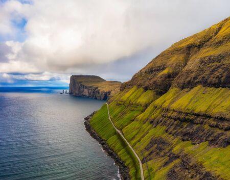 Bay with Risin and Kellingin sea stacks on Faroe Islands