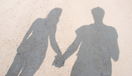 Shadow of couple holding hands Stok Fotoğraf