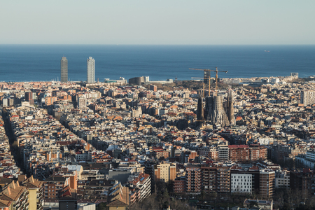 This is the spectacular view of Barcelona in Spain. It is a sunny day and it is possible to distinguish many monuments.