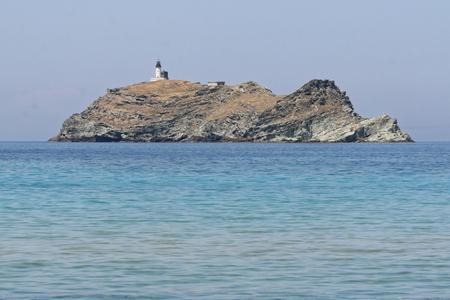 Islet with a lighthouse Reklamní fotografie