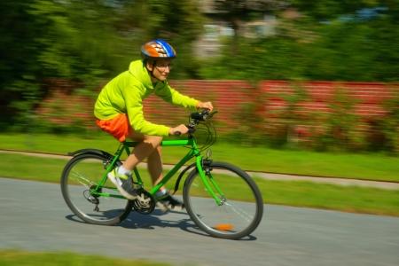 Cycling, teenager riding a bike