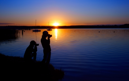 Photographers and sunset over the lake