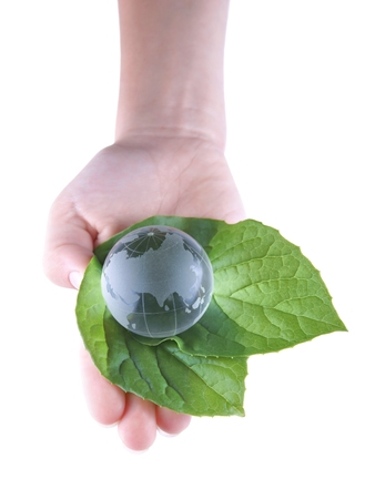 globe theatre: Glass Globe in the leaves and the child s hand, isolated on white background