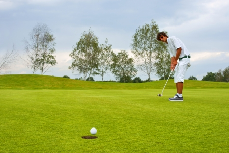 Golf, Golfer thrusting the ball into the hole