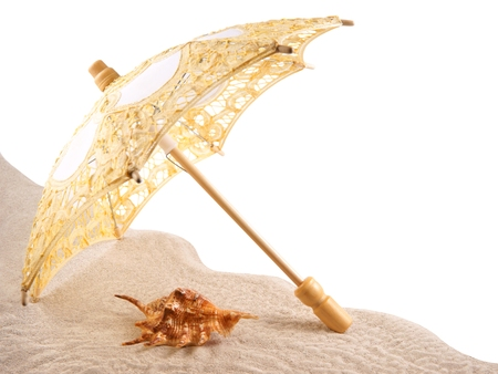 Shell under an umbrella on the sand, white background Stock Photo - 23365258