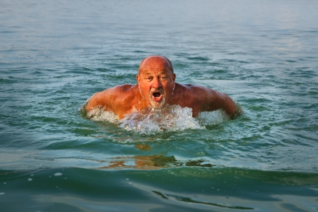 Swimmer  Senior man swimming butterfly strokes  Caucasian male aged 60 years