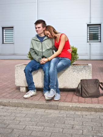 clinging: Boy and girl, teens clinging to each other