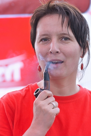 Woman smokes a pipe photo