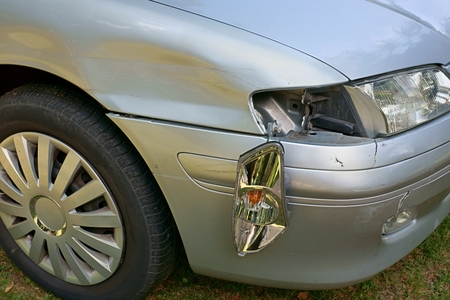 Car crash, the vehicle with a damaged fender, bumper and blinker