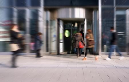 People in busy pedestrian shopping street Фото со стока