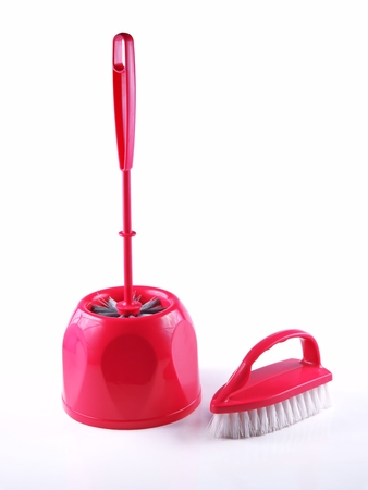 scrubbing up: Cleaning brush and to toilets, on a white background Stock Photo