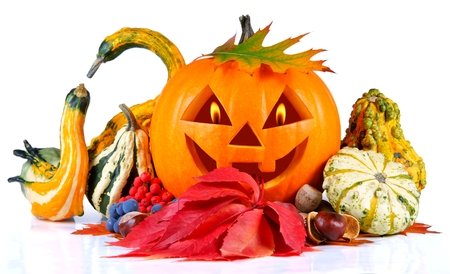 Halloween, pumpkin, autumn composition, old jack-o-lantern on white background with fiery flames in the eyes photo