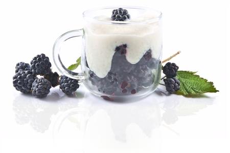 rubus: Blackberries (Rubus fruticosus), dessert with cream in a glass