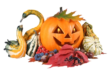 Pumpkin, halloween, old jack-o-lantern on white background with fiery flames in the eyes, composition out of figurine devil photo