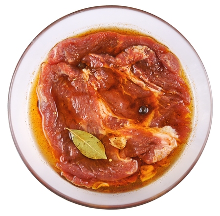 marinade: Meat, Pork in marinade on a glass plate Stock Photo