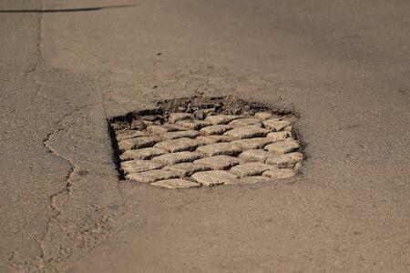big hole on the street car trap,