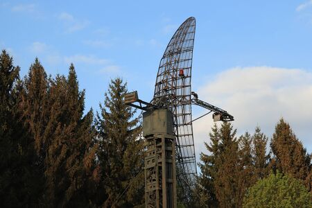 old radar system in the forest