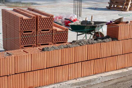 Construction site. Brick wall and mortar