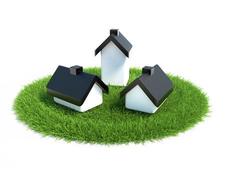 house located on the grass symbolizing land for the construction of housing Stock Photo