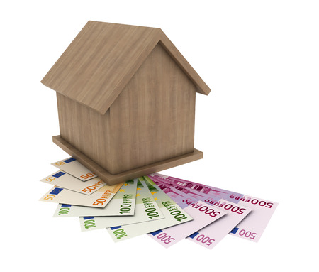 a small wooden house stands on the banknotes of the euro  Stock Photo