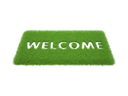 welcome sign: print the words are welcome on the mat of green grass Stock Photo