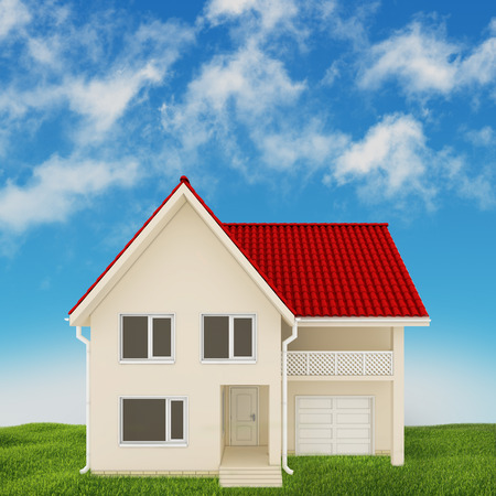 modern home located on the lawn on a background of blue sky photo