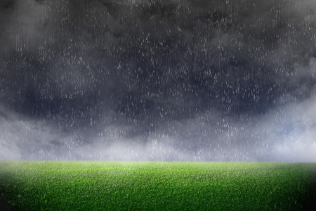 Image of stadium in dark and rain  background of green lawn